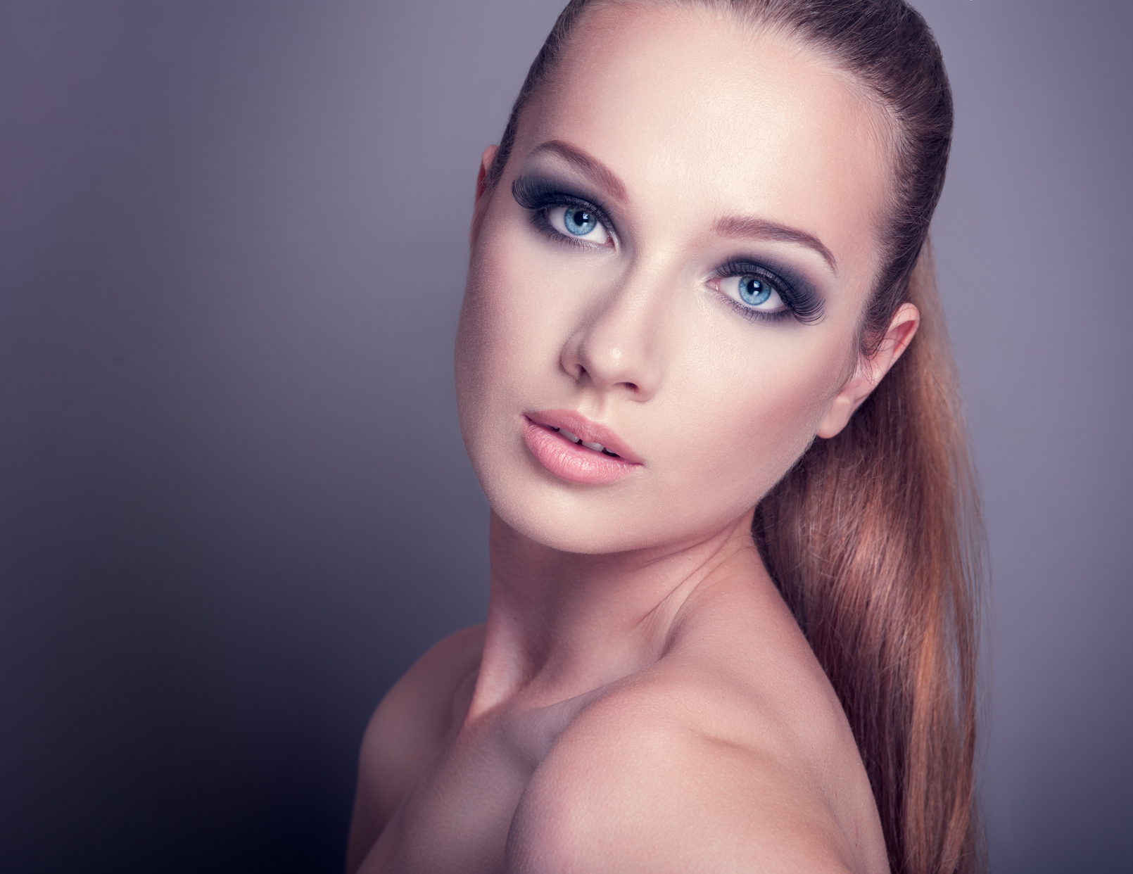 beautiful woman on a dark background with smoky eye makeup